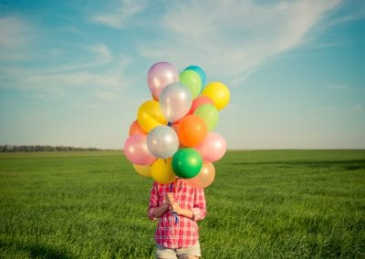 woman with toy balloons in spring field PYD9GRS 400x284 - Corporate events